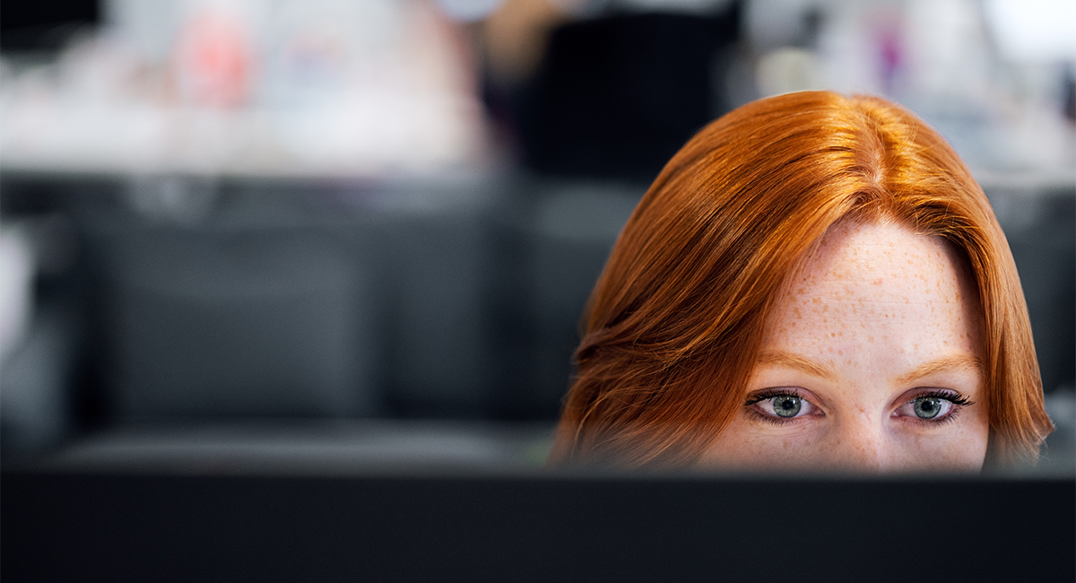 Redhead woman working at her computer