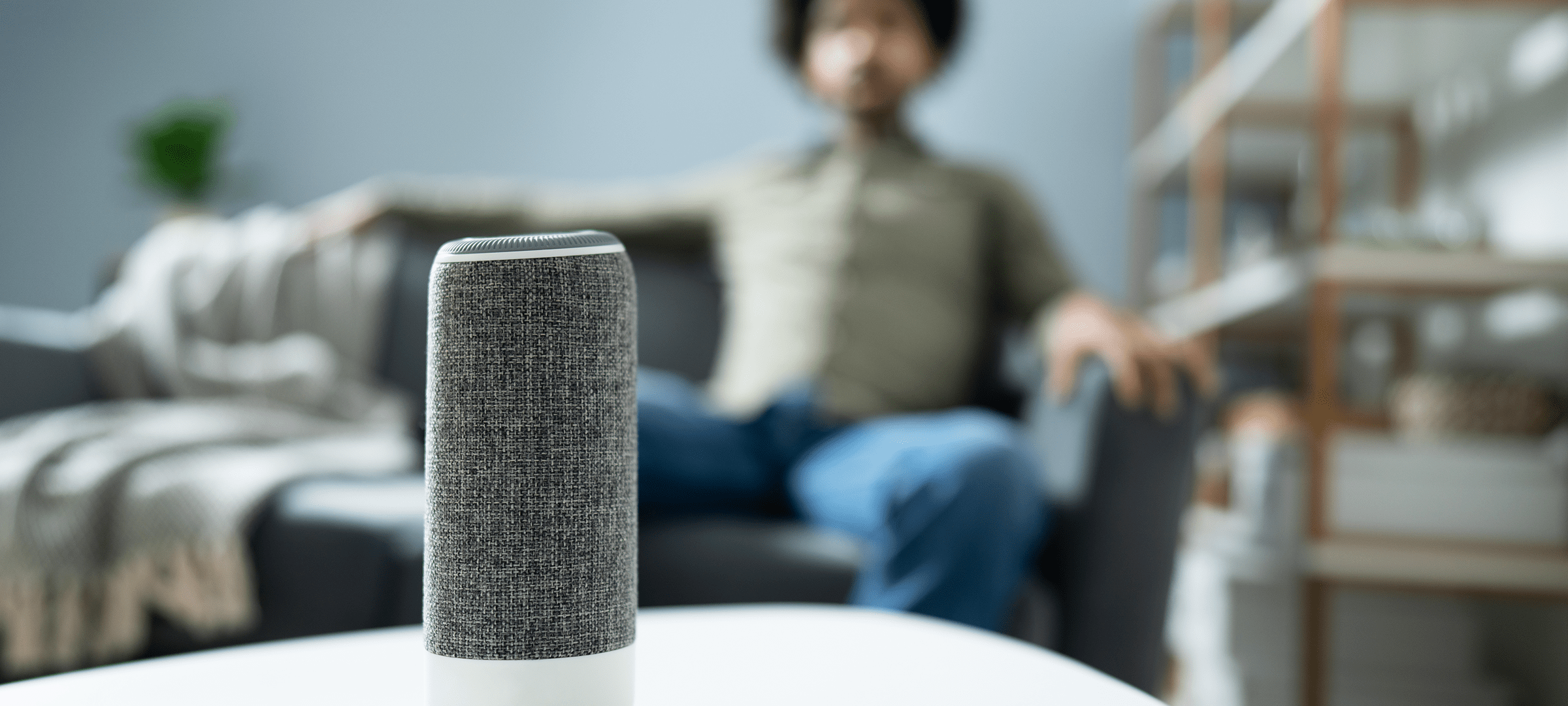 Man sitting with Voice Controlled Device