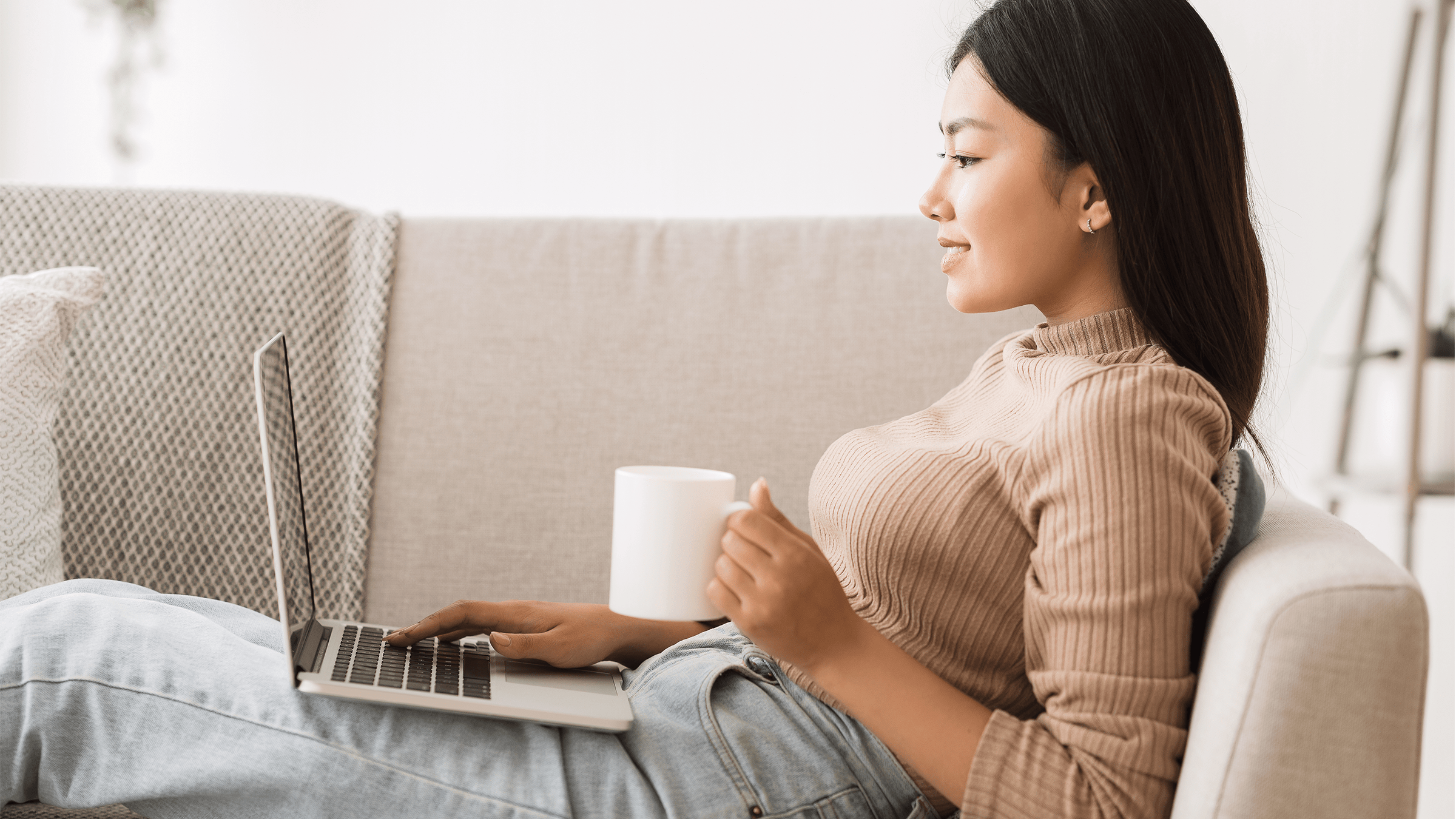 woman sitting down using social ecommerce